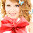 Royalty-Free Stock Photo: Butterfly girl with gift