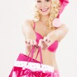 Santa helper with pink shopping bags — Stock Photo #3262972