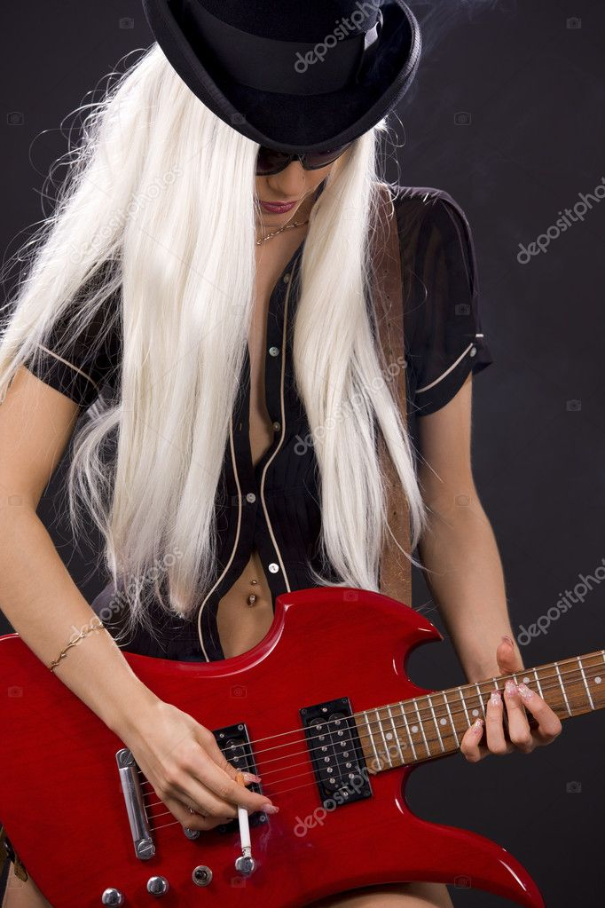 Woman in top hat with red electric guitar and cigarette — Stock Photo #3262496
