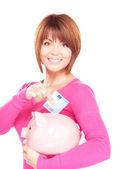 Belle femme avec piggy bank et de l'argent — Photo