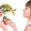 Lovely woman with apple twig - Stock Photo