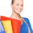 Young attractive businesswoman with folders — Stock Photo #3314533
