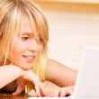 Teenage girl with laptop computer — Stock Photo