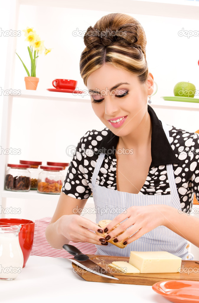 Picture of beautiful woman in the kitchen  Stock Photo #3314563