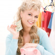Lovely woman with piggy bank and money — Stock Photo #3326616