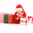 Santa helper baby with christmas gifts — Stock Photo #3330362