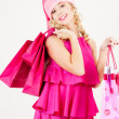 Cheerful santa helper girl with shopping bags — Stockfoto
