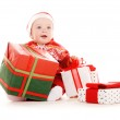 Santa helper baby with christmas gifts — Stock Photo #3331273