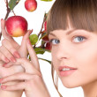 Stock Photo: Lovely womwith apple twig