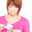 Lovely woman with purse and money — Stock Photo #3341104