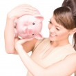 Lovely woman with piggy bank — Stock Photo #3341442