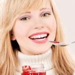 Happy teenage girl with raspberry jam — Stock Photo #3354341