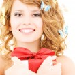 Butterfly girl with gift — Stock Photo #3355949