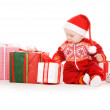 Santa helper baby with christmas gifts — Stock Photo #3356151