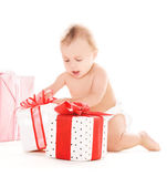 Baby boy with gifts — Stock Photo