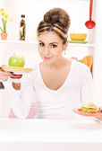 Woman with green apple and sandwich — Stock Photo