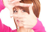 Lovely woman creating a frame with fingers — Stock Photo
