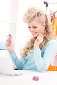Lovely woman with calculator and computer — Stock Photo
