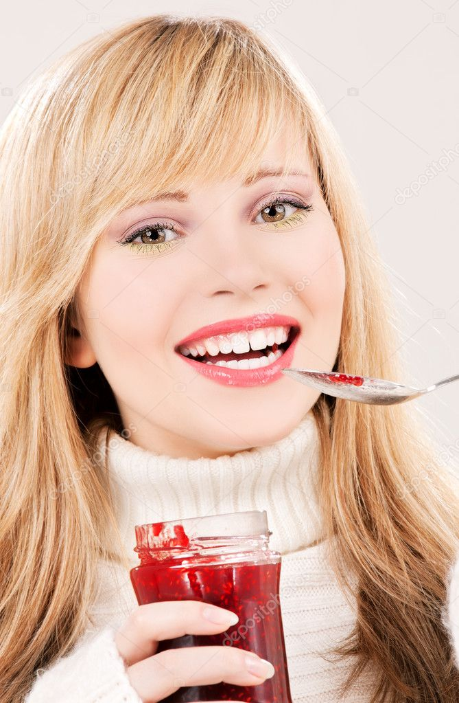 Picture of happy teenage girl with raspberry jam  Stock Photo #3354341