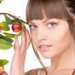 Lovely woman with apple twig — Stock Photo #3372878