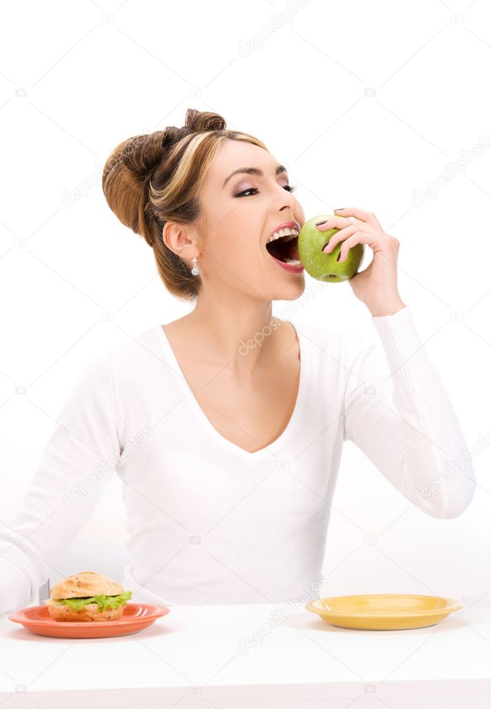 Picture of woman with green apple and sandwich — Stock Photo #3372638