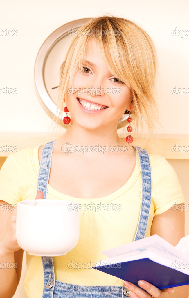 Picture of teenage girl with book and mug — Stock Photo #3372698