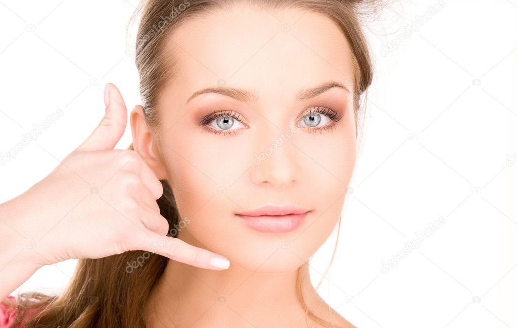 Picture of lovely woman making a call me gesture — Stock Photo #3388050