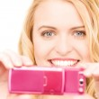 Happy woman using phone camera — Stock Photo #3401257
