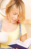 Teenage girl with book and mug — Stock Photo