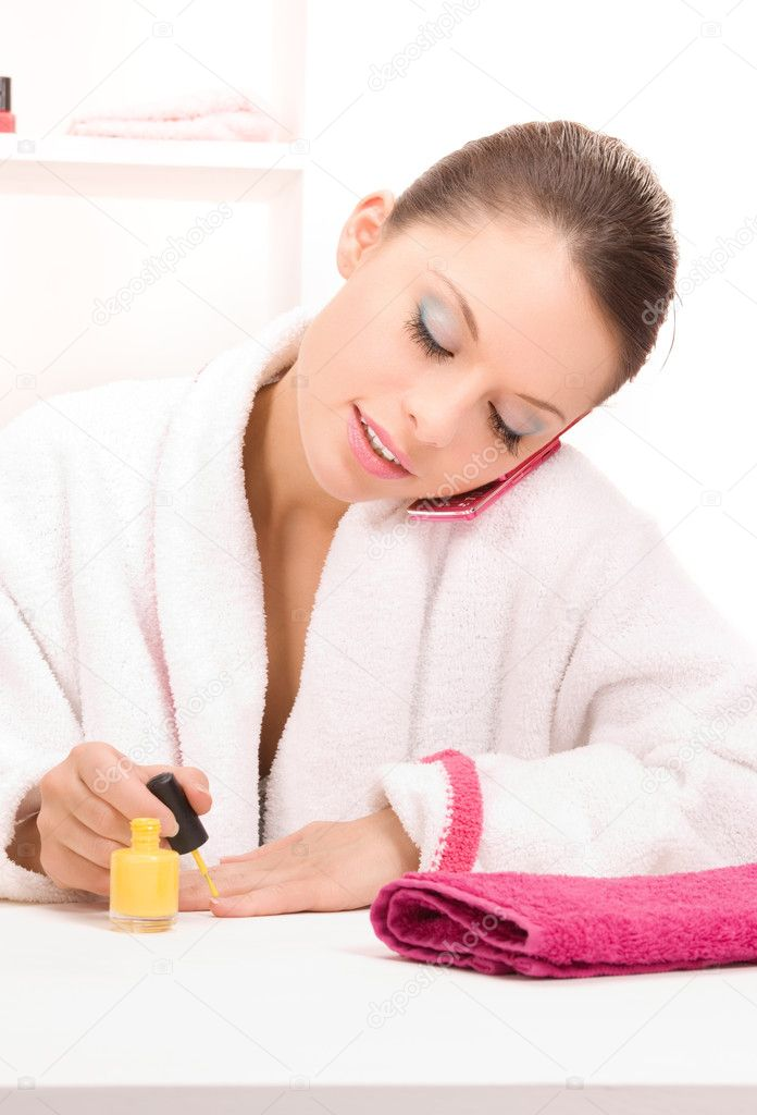 Bright picture of woman polishing her nails  Stock Photo #3401057