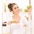 Woman with green apple and sandwich — Stock Photo #3414446
