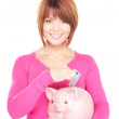 Lovely woman with piggy bank and money — Stock Photo #3414820