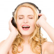 Happy woman in headphones — Stock Photo #3415430