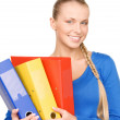 Young attractive businesswoman with folders — Stock Photo #3415673