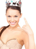 Woman in crown showing devil horns gesture — Stock Photo