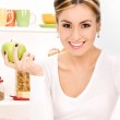 Young beautiful woman with green apple — Stock Photo #3425788