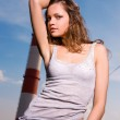 Young sexy woman in blue jeans — Stock Photo