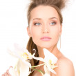 Beautiful woman with white flower — Stock Photo