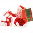 Santa helper baby with christmas gifts — Stock Photo #3450229