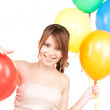 Happy teenage girl with balloons — Stock Photo #3450598