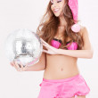 Santa helper in pink lingerie with disco ball — Stock Photo