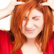 Unhappy redhead woman - Stock Photo