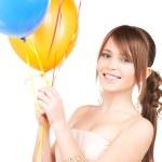 Happy teenage girl with balloons — Stock Photo #3451136
