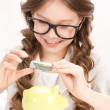 Little girl with piggy bank and money — Stock Photo #3458391