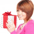Happy woman with gift box - Stockfoto