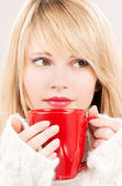 Lovely teenage girl with red mug — Stock Photo