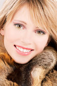 Lovely teenage girl in fur — Stock Photo