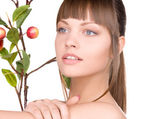 Lovely woman with apple twig — Stock Photo