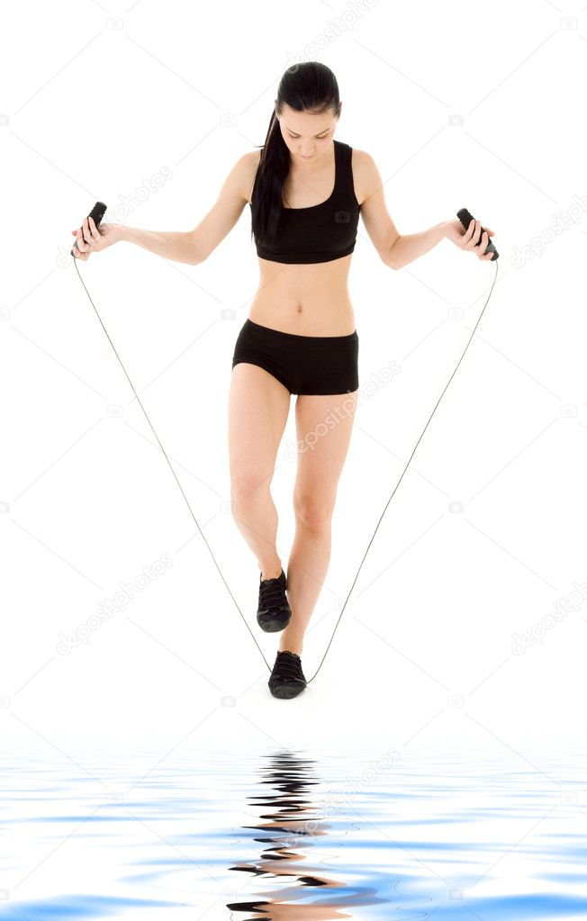 Lovely woman with jump rope over white — Stock Photo #3450200