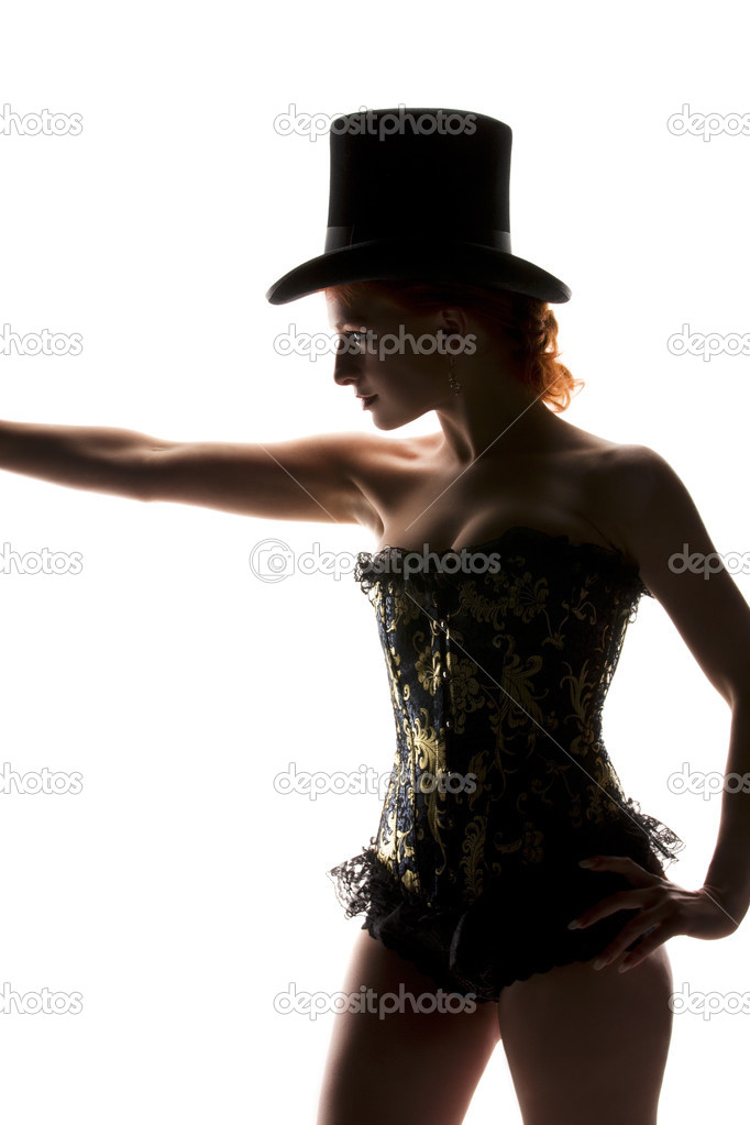 Silhouette backlight picture of sexy woman in corset — Stock Photo #3450575